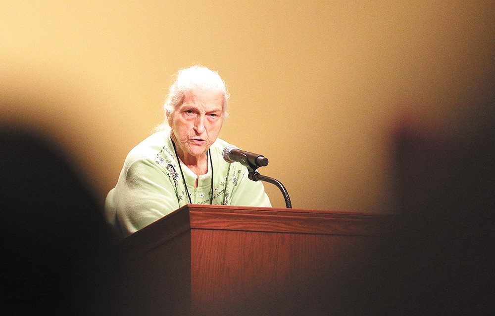 Longtime women's rights activist Sally Jackson riles up the crowd inside the Spokane Convention Center. - YOUNG KWAK