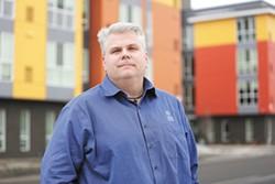 Rob McCann, director of Catholic Charities - YOUNG KWAK