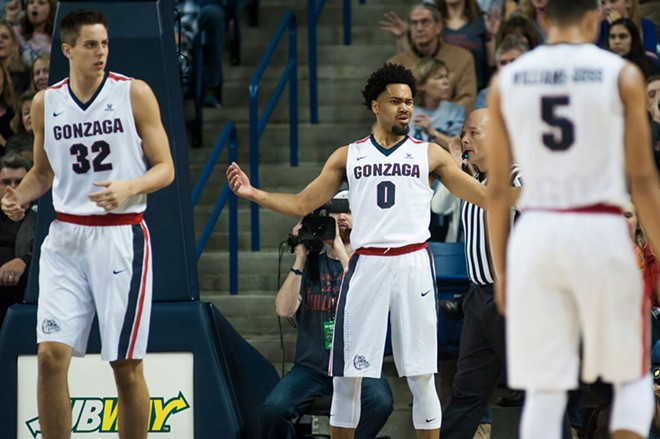 Silas Melson (center) stepped up with Nigel Williams-Goss injured and unable to play Saturday. - AUSTIN ILG