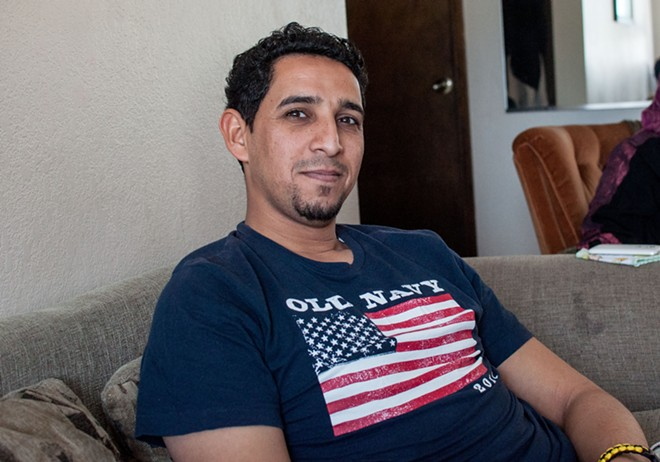 Assad Al-Sawaedi, sitting in his brother's house on Monday, says he loved his Old Navy shirt with the big American flag on it. But, for obvious reasons, he didn't feel all that safe wearing it in public in Iraq. - DANIEL WALTERS PHOTO