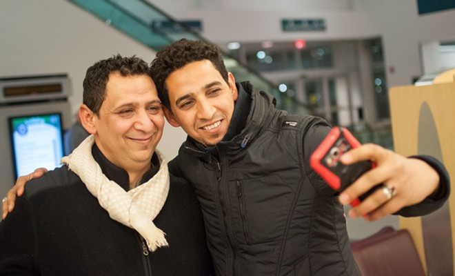 Reunited after many years, Hamid Nahi and his brother Assad Al-Sawaedi take a selfie to celebrate. - DANIEL WALTERS PHOTO