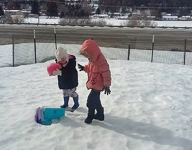 Rahaf Al-Sawaedi wanted to play with her 2-year-old cousin Rya in the snow, but when Trump's order came down, she was worried that it would melt before she would arrive in America. On Sunday, they finally got a chance to play in the snow. - PHOTO COURTESY OF HAMID NAHI