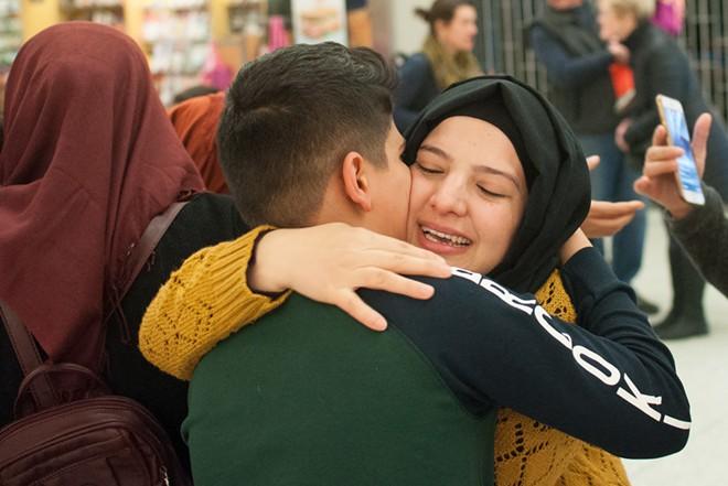 Asma Abdul Almhos hugs Omar Khairi, a 12-year-old refugee from Iraq. - DANIEL WALTERS PHOTO