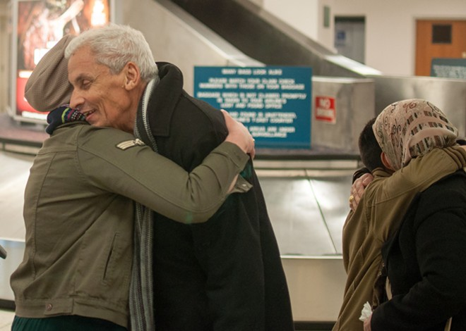 Iraqi refugees Talib Baghdadi and Montaha Alsammarraie greet family members after arriving in America. - DANIEL WALTERS PHOTO
