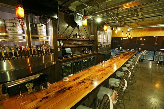 Manito Tap House offers more than a hundred beers on tap and in bottles and cans. - COURTESY MANITO TAP HOUSE