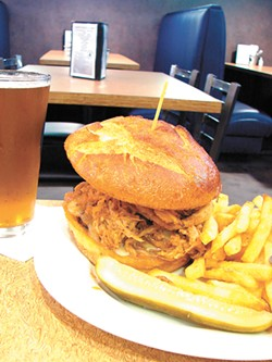 Menu classics include a pulled pork sandwich. - CARRIE SCOZZARO