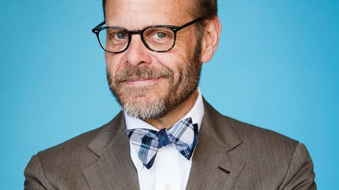Alton Brown plays with his food Wednesday at the INB.