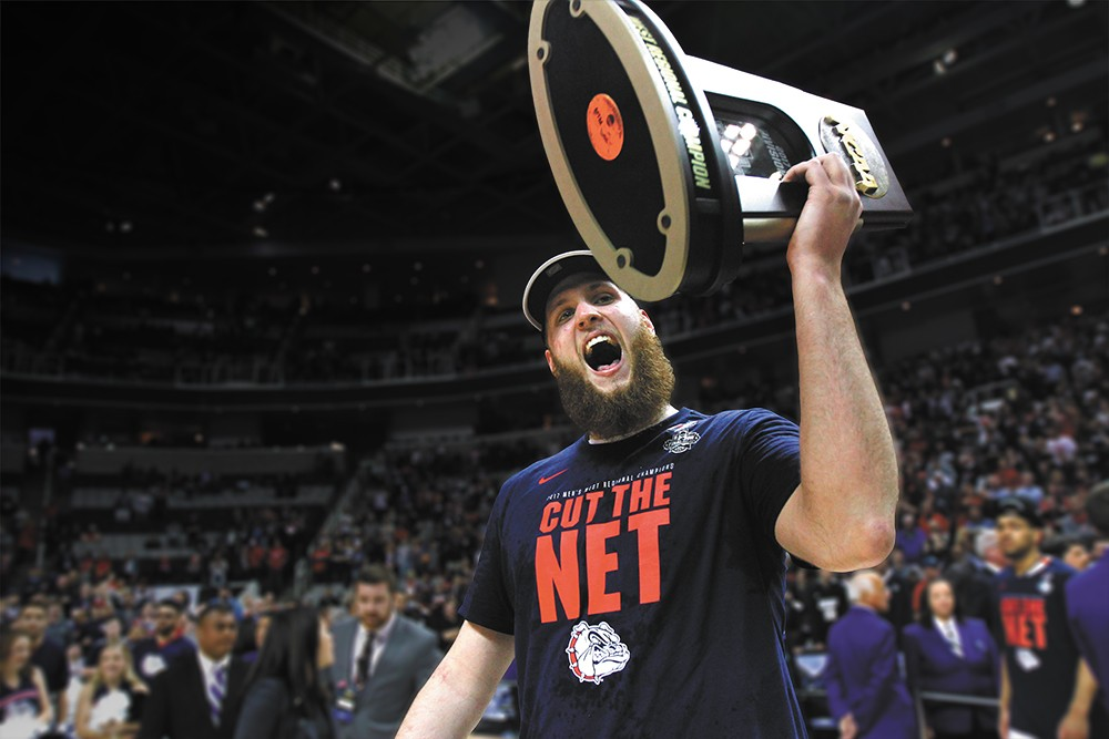 Przemek Karnowski hoists the West Regional trophy in celebration of Gonzaga's first trip to the Final Four. - TORREY VAIL/GONZAGA ATHLETICS PHOTO