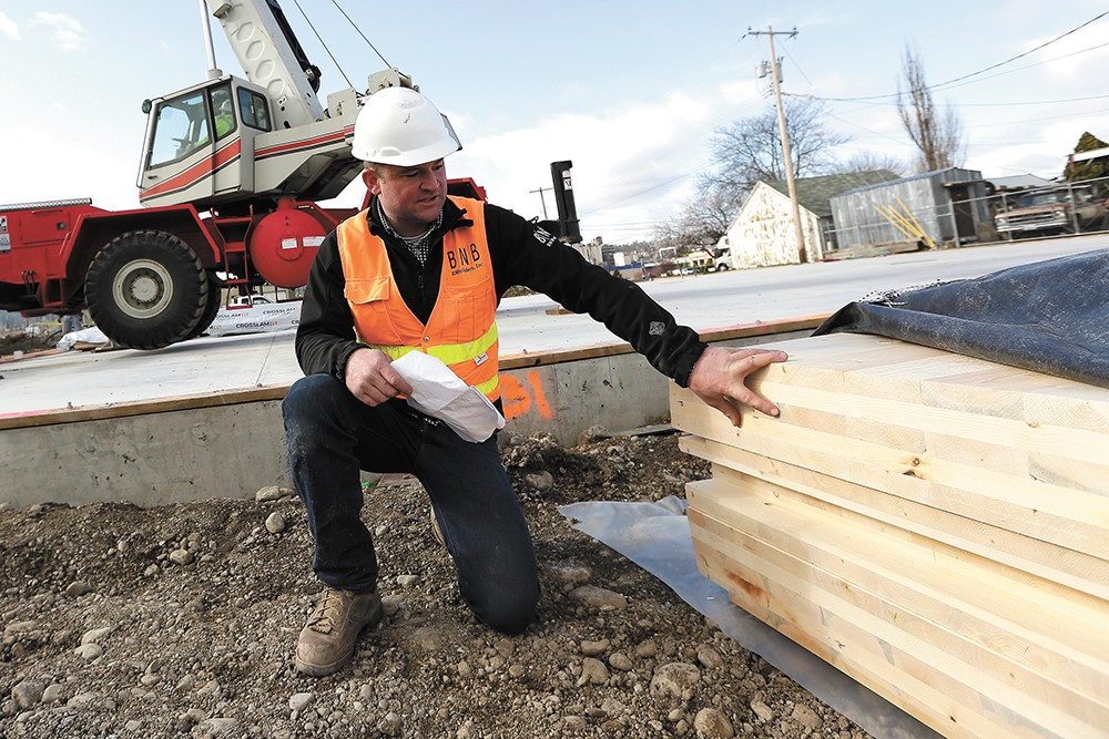 "Beacon Builders' Mike Bradley says of cross-laminated timber: ""I'm always interested in anything that's innovative or sustainable or both, and this is both."" - YOUNG KWAK"