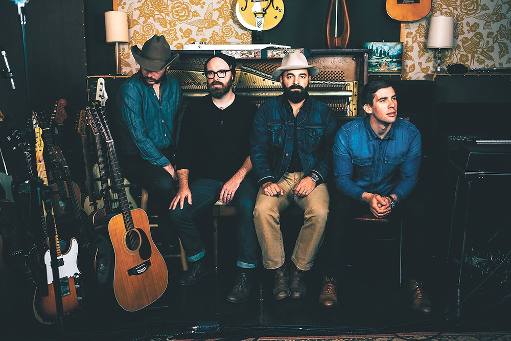 Drew Holcomb (second from right) and the Neighbors, who play Spokane for the first time on May 4.