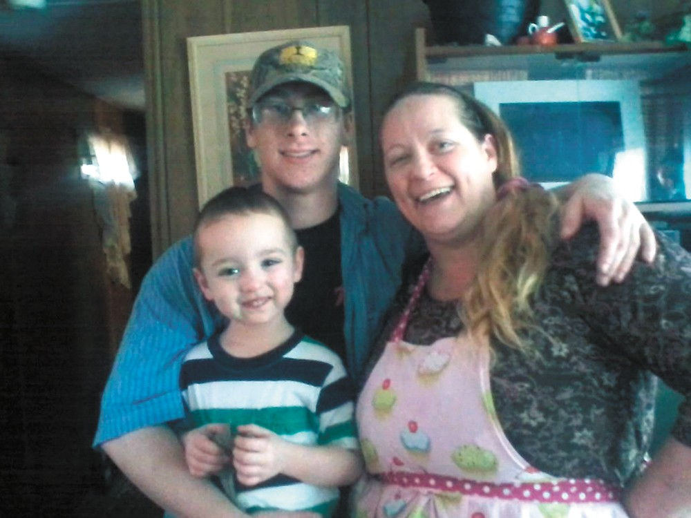 Tim Moore with his mom and little brother.