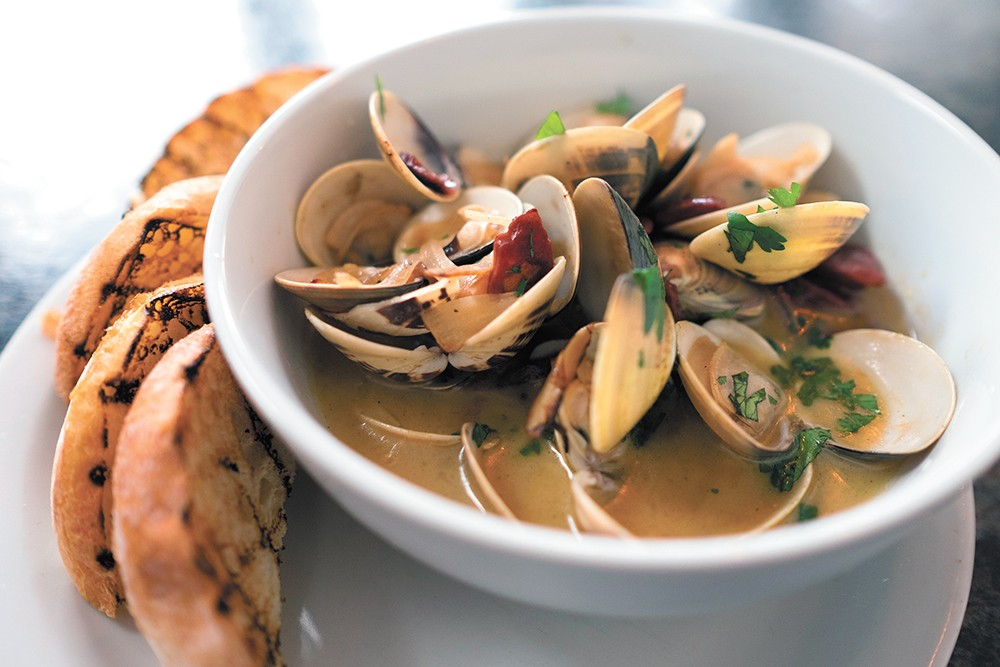 Steamed clams are just one of Craft & Gather's varied pub fare offerings. - HECTOR AIZON
