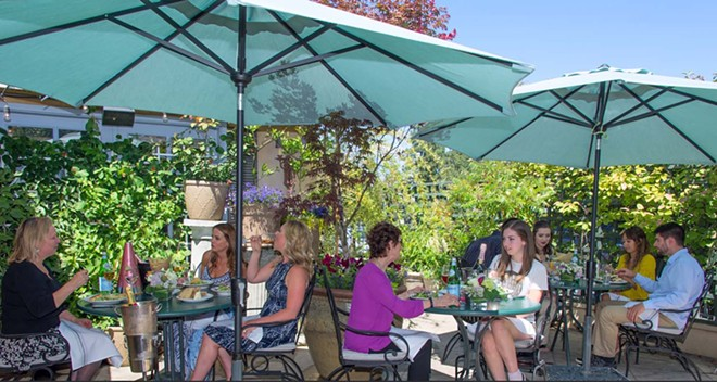 Soak up the spring warmth on Luna's secluded, greenery-filled patio. - LUNA