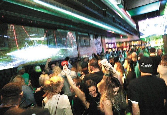 A packed dance floor at The Globe Bar & Kitchen. - YOUNG KWAK PHOTO
