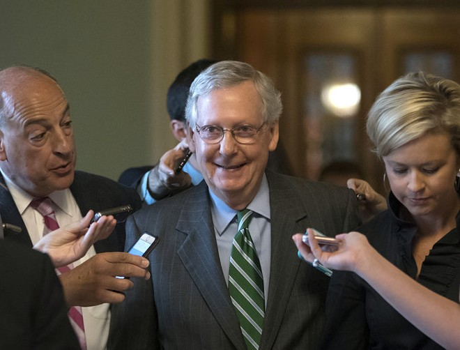 Senate Majority Leader Mitch McConnell may be happy, but experts worry that by eliminating the individual mandate, the Senate's proposed health care bill threatens to tank the individual market.