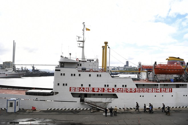 """The North Korean ferry boat Man Gyong Bong arrives to the port of Vladivostok, Russia, June 15, 2017. North Korea, in desperate need of foreign currency, has sent tens of thousands of its impoverished citizens across its border where they are welcomed as """"fast, cheap and reliable"""" laborers. - JAMES HILL/THE NEW YORK TIMES"""