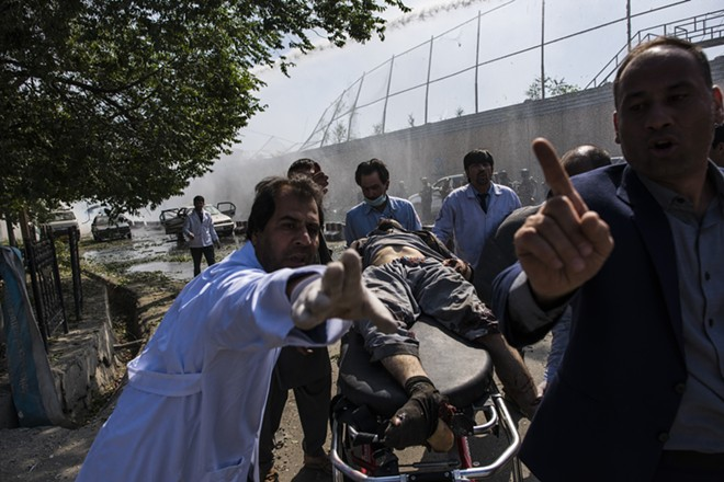 An injured man is taken to an ambulance near the site of a truck bombing that exploded near the Afghan presidential palace and several major foreign embassies, in central Kabul, Afghanistan, May 31, 2017. The long war in Afghanistan continues to set records for civilian casualties, the United Nations mission in the country said on July 17, even as the violence is expected to intensify in the coming months with no hope of peace talks anytime soon. In the first half of 2017, 1,662 civilians were killed, surpassing a record set last year during the same period. - ANDREW QUILTY/THE NEW YORK TIMES