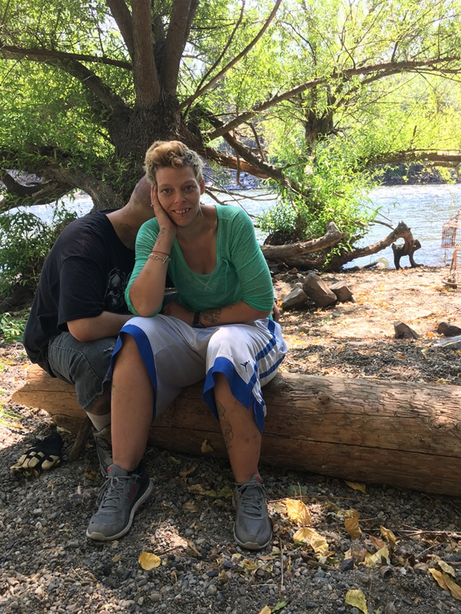 Destiny Brown was given three hours to clean up all her belongings and leave the campsite along the Spokane River where she'd been living for two months. - MITCH RYALS PHOTO