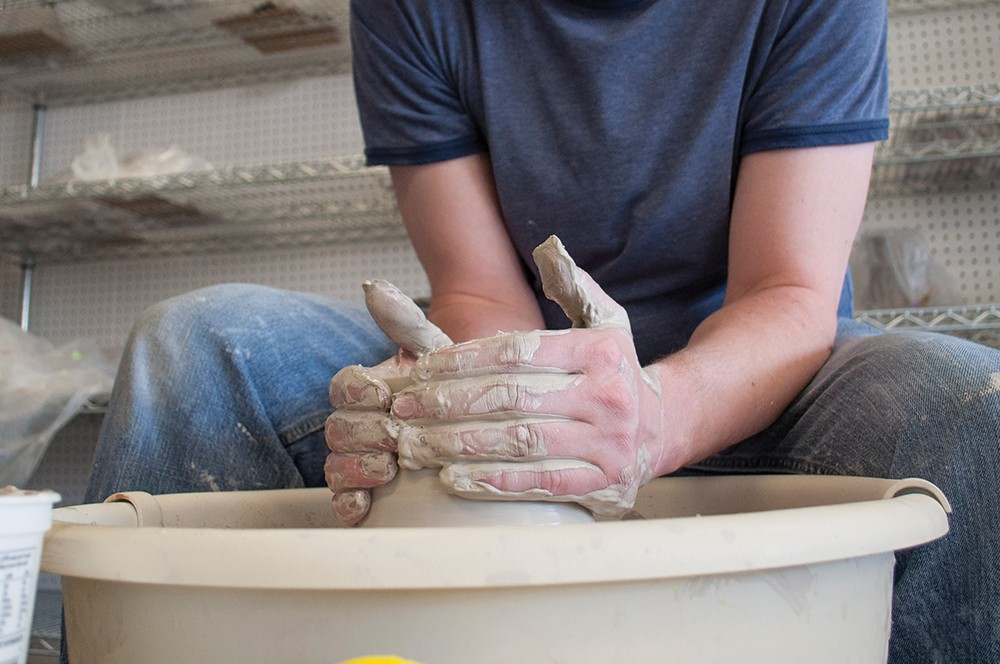 Students at Spokane's Urban Art Co-Op can opt to work on the pottery wheel. - SARAH WURTZ