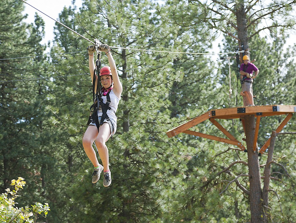 Mallory Johnson zips down the line at Mica Moon Zip Tours near Liberty Lake. - TIMOTHY PHILLIPS