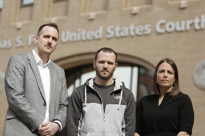 Jerad Kynaston (center) pleaded guilty to a drug charge to avoid a mandatory life sentence for growing weed. - YOUNG KWAK PHOTO