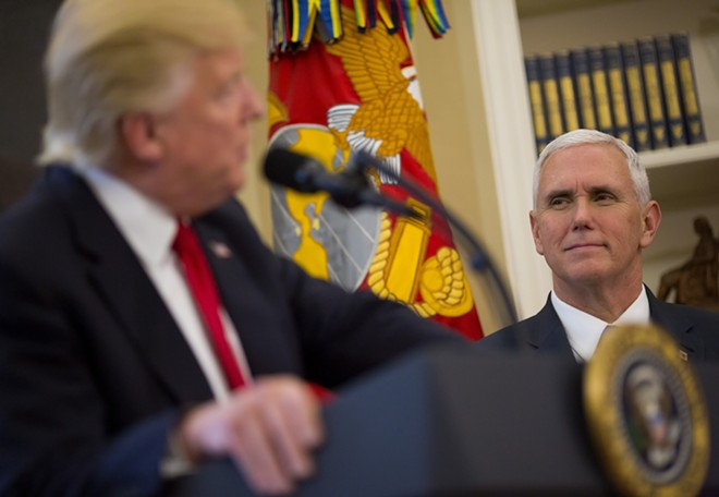 Vice President Mike Pence looks at President Donald Trump in the Oval Office of the White House in Washington, March 31, 2017. Pence appears to be cementing his status as Trump's heir apparent, promoting himself as the conduit between Republican donors and the administration. - ERIC THAYER/THE NEW YORK TIMES