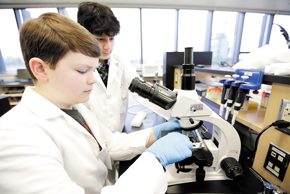Jacob Gannon (left) and Sujal Rijal at work during a microbiology class at North Central High School. - YOUNG KWAK