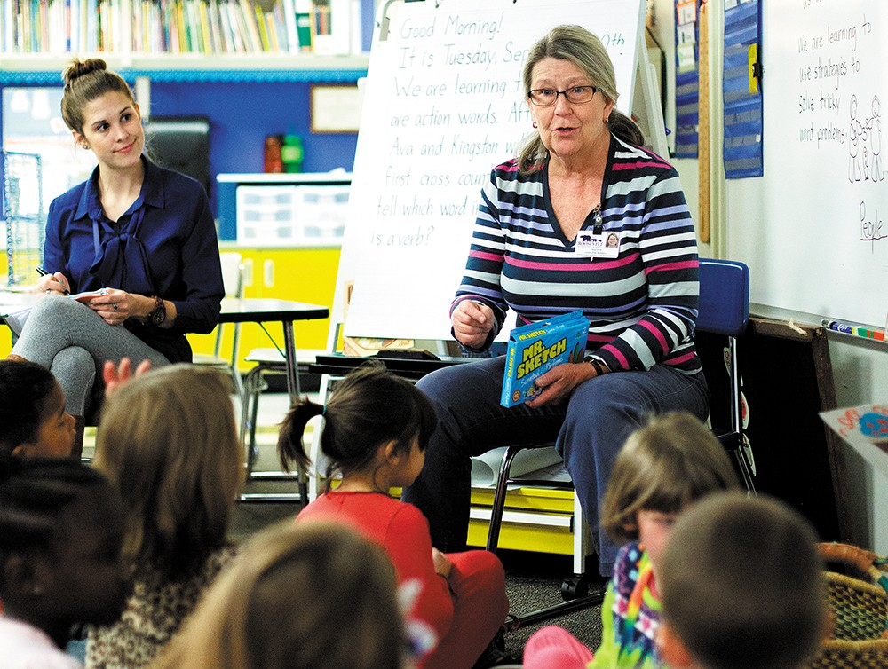 First-grade teacher Char Russell speaks with students at Roosevelt Elementary School. - YOUNG KWAK