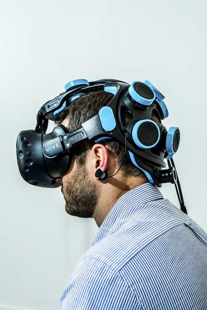 Michael Thompson, vice president of business development at Neurable, wears a headset that is part of the prototype for a game that lets users control actions with their thoughts, in San Francisco, July 7, 2017. The prototype is among the earliest fruits of a widespread effort to embrace technology that was once science fiction — and in some ways still is. - CHRISTIE HEM KLOK/THE NEW YORK TIMES