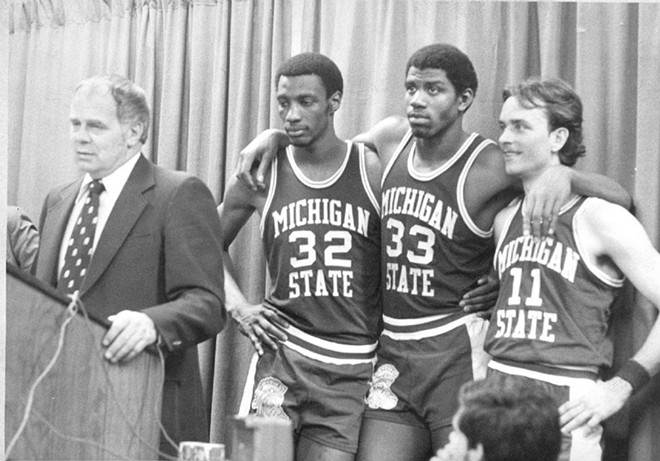 Jud Heathcote, with Greg Kelser, Earvin Johnson and Terry Donnelly, meeting the media after winning the national championship on March 26, 1979, by a score of 75-64 over Larry Bird's Indiana State Sycamores. - MICHIGAN STATE ATHLETICS