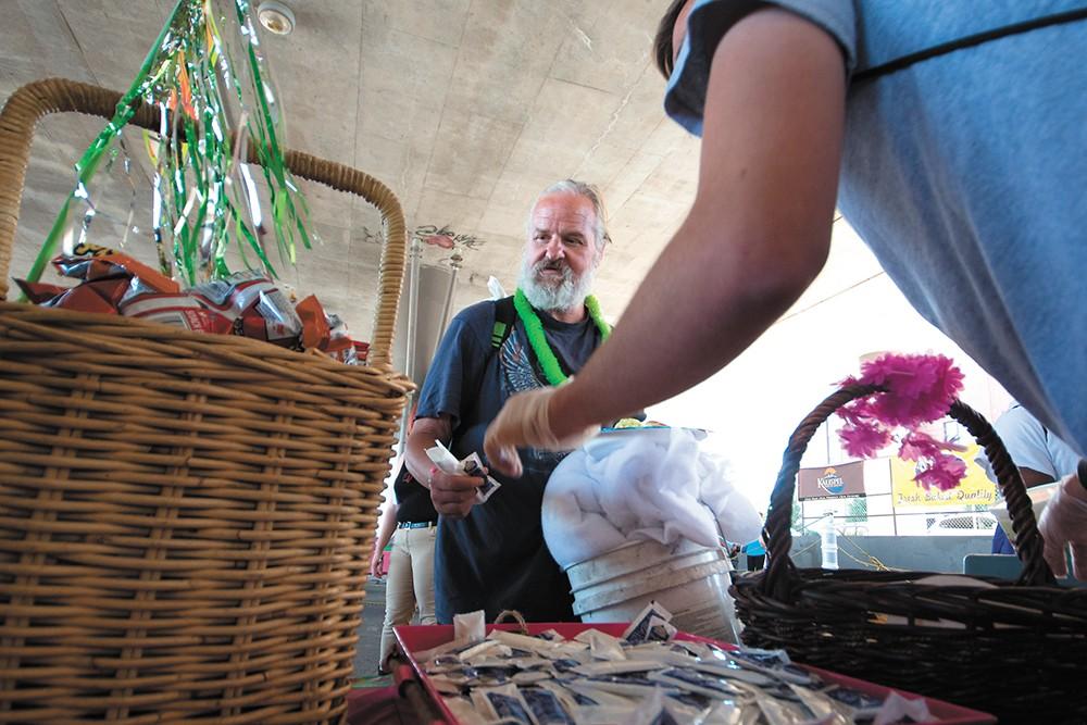 Vinny Ash gets a plate at Saturday's luau. - STUART DANFORD