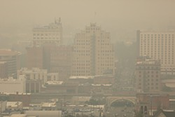 A photo of downtown Spokane enveloped in smoke from wildfires last month. - YOUNG KWAK