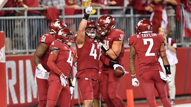 WSU linebacker Peyton Pelluer, center, celebrates with teammates after returning an interception 36 yards for a fourth-quarter touchdown that cut Boise State's lead to 31-23 with 5:51 on the clock. The Cougs won 47-44 in three OTs. - WSU ATHLETICS