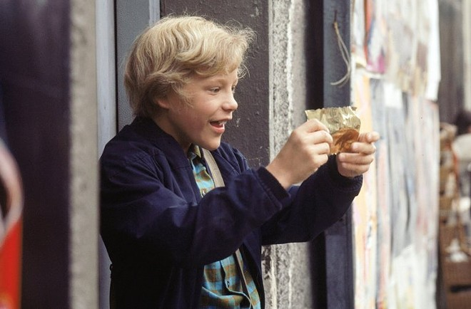 "The character Charlie Bucket in the 1971 film ""Willy Wonka and the Chocolate Factory."""