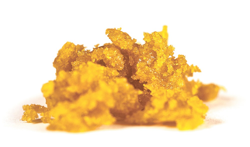 A press, applying heat and pressure, produces a concentrate without solvents.
