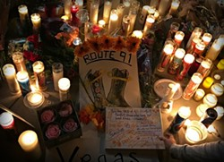 A shrine to the victims of Sunday night's mass shooting in Las Vegas continues to grow amid new revelations about the crime. - THE NEW YORK TIMES