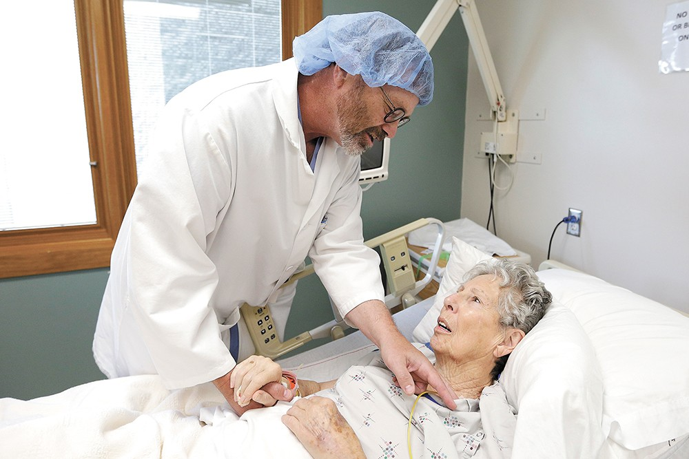 Steve Beckstrom checks on Josephine Johnson, a colon cancer patient, at Lincoln Hospital in Davenport. - YOUNG KWAK