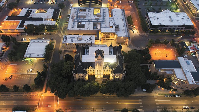 The Spokane County Courthouse and surrounding buildings light up the night sky. - BRYCE J. LEMING PHOTO