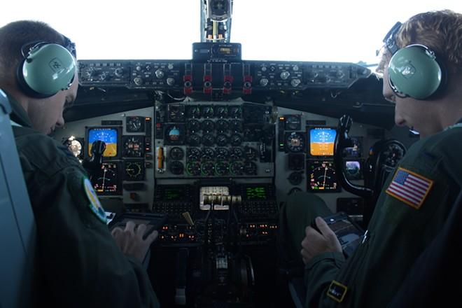 Captain David Leibrand, left, and 1st Lt. Adam Less look over tablets with Thursday's flight plan. - SAMANTHA WOHLFEIL PHOTO