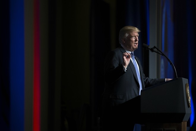 "President Donald Trump speaks at the Heritage Foundation's annual President's Club meeting in Washington, Oct. 17, 2017. Trump has denied a congresswoman's account that he told a grieving soldier's widow in a phone call that the soldier ""knew what he signed up for,"" saying on Oct. 18 that the Democratic representative's description was ""totally fabricated."" - TOM BRENNER/THE NEW YORK TIMES"