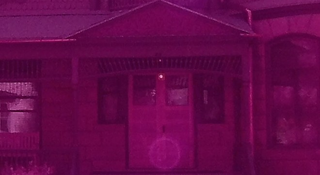 Spokane Paranormal Society co-founder Mark Porter snapped this photo that appears to show a woman in the doorway of the old home once occupied by the mayor in the early 1900s in Deadwood, South Dakota. - MARK PORTER