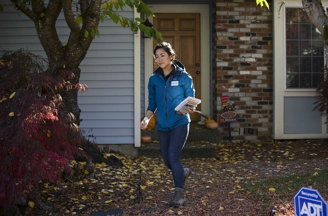 "Jinyoung Lee Englund, the Republican candidate for Washington State Senate, canvasses in Woodinville, Wash., Oct. 31, 2017. Englund, a polished former political operative, has campaigned explicitly against the ""blue wall"" scenario, warning that voters should not let Washington ""go the way of California"" and other one-party states. - RUTH FREMSON/THE NEW YORK TIMES"