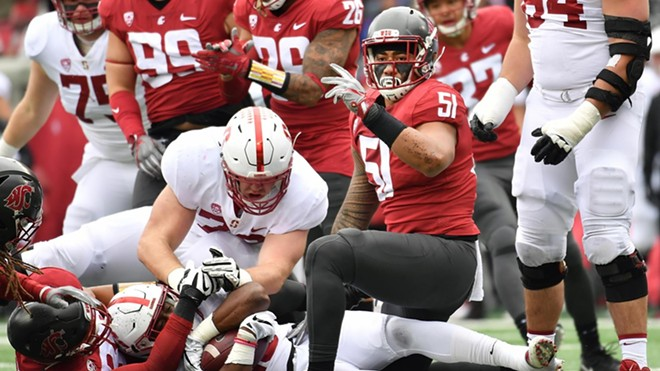 Washington State's defense, with linebacker Frankie Luvu (51) — one of 20 seniors taking the field at Martin Stadium for the final time — leading the way, held Stanford standout Bryce Love to a season-low 69 yards on 16 carries. - WSU ATHLETICS