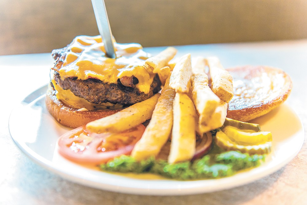 "The ""Unbeatable Eagle"" is one of the grill's 11 hand-pressed burgers. - ERICK DOXEY"