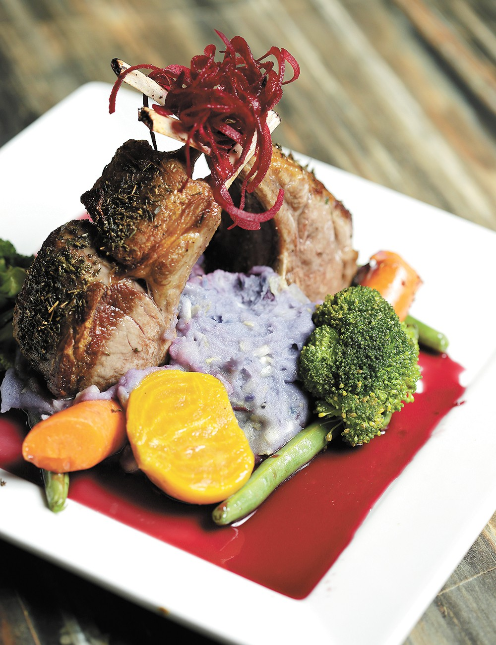 Purple potatoes give an unexpected hue to colcannon served with lamb chops at Satay Bistro. - YOUNG KWAK