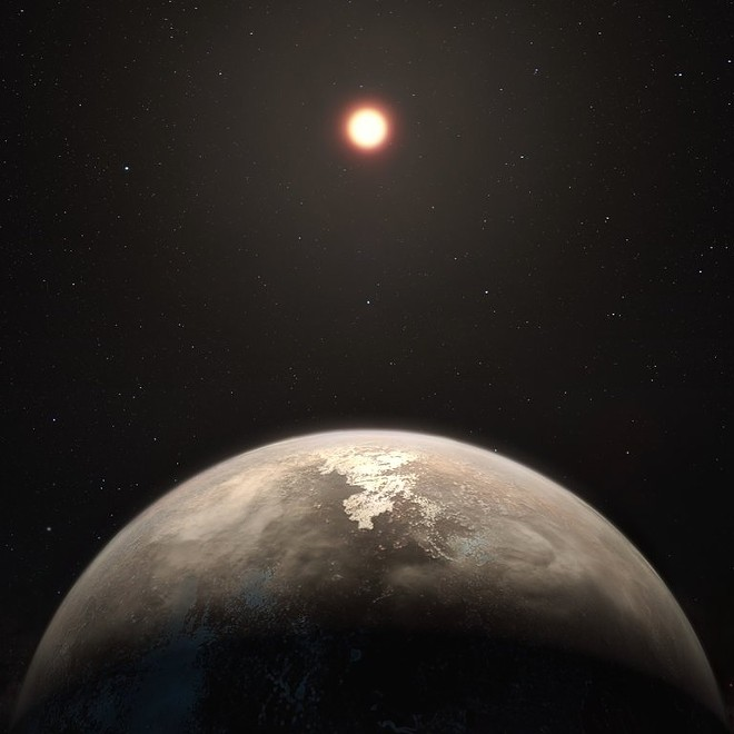 An artist's impression of a newly discovered planet and its red dwarf star, Ross 128. The planet, 11 light-years away, is roughly the size of Earth but closer to Ross 128 than our planet, or even Mercury, is to our sun. - M. KORNMESSER/EUROPEAN SOUTHERN OBSERVATORY
