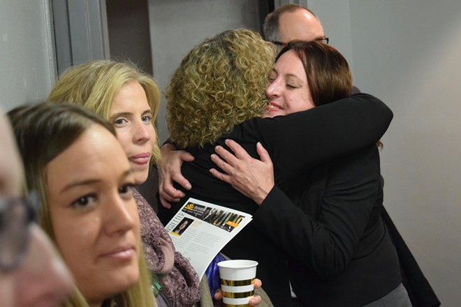 Daybreak CEO Annette Klinefelter, right, hugging Bev Coplin on Tuesday at the opening of the new psychiatric evaluation and treatment center for girls under 18 in downtown Spokane. - WILSON CRISCIONE PHOTO