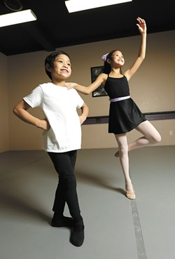 Siblings Jude and Olivia Rodriguez are two of the 90 local children performing alongside professional dancers this weekend in The Nutcracker Ballet. - YOUNG KWAK