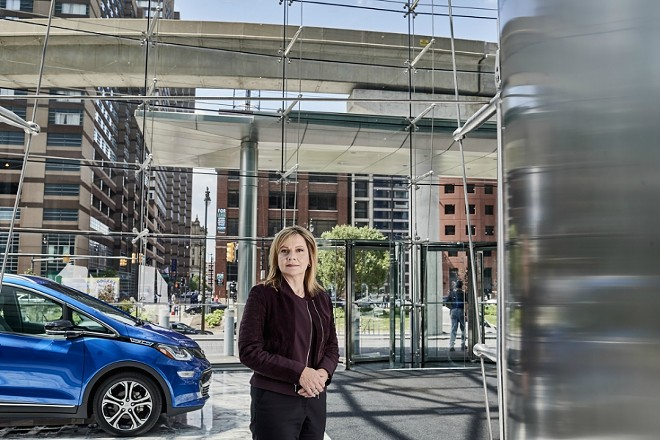 """Mary Barra, the chief executive of General Motors, with a self-driving Chevrolet Bolt EV at GM headquarters in Detroit, June 2, 2017. GM is redirecting energy and capital toward a race with Silicon Valley to create self-driving cars. """"We are very, very serious and intent on putting something on the road,"""" Barra said of the company's automated vehicles. """"We definitely want to be first."""" - JOE VAUGHN/THE NEW YORK TIMES"""