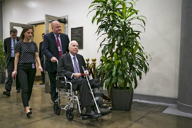 Sen. John McCain (R-Ariz.) arrives for the weekly Republican policy luncheon, on Capitol Hill in Washington, Dec. 5, 2017. McCain, who is battling brain cancer, appears likely to miss the Senate's vote this week to approve a sweeping tax overhaul, but his absence is not expected to jeopardize its passage. - AL DRAGO/THE NEW YORK TIMES